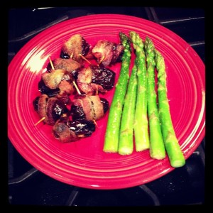 Dated, stuffed with walnuts, wrapped in bacon + some asparagus.